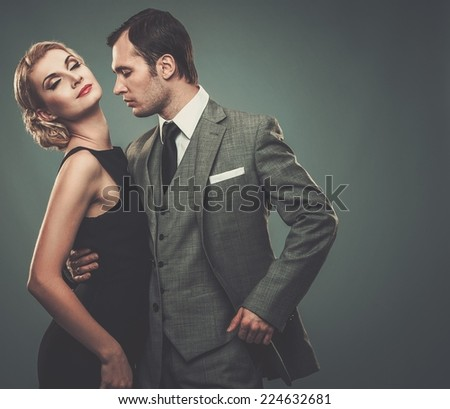 Well-dressed retro couple  - stock photo