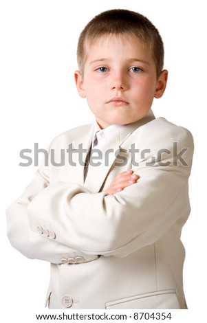 Well-dressed serious boy like businessman. Isolate on white