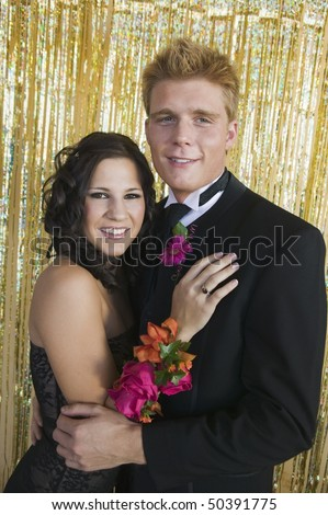 Well-dressed teenagers at school dance, portrait - stock photo