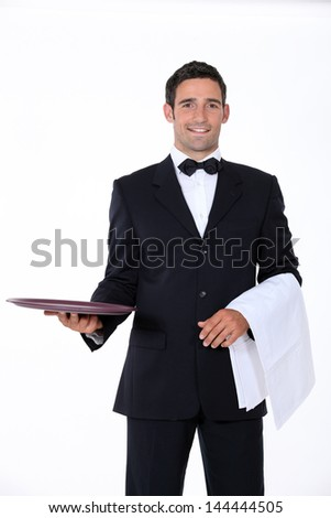 well dressed waiter facing the camera - stock photo