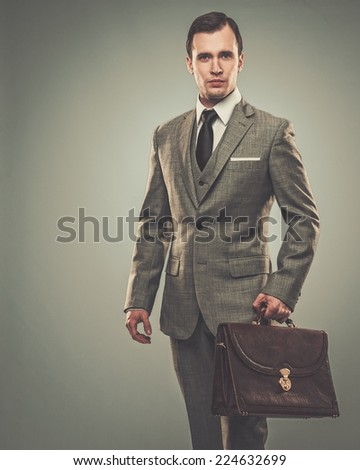Well-dressed young businessman with a briefcase  - stock photo