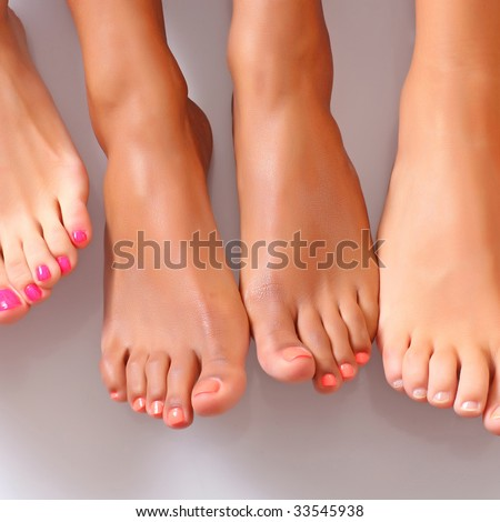 Well-groomed bared a foot of female feet - stock photo