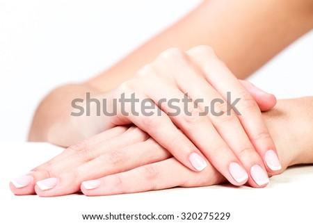 Well-groomed female hands - stock photo