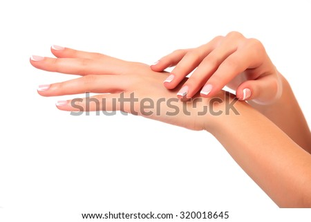 Well-groomed female hands, isolated on white background - stock photo