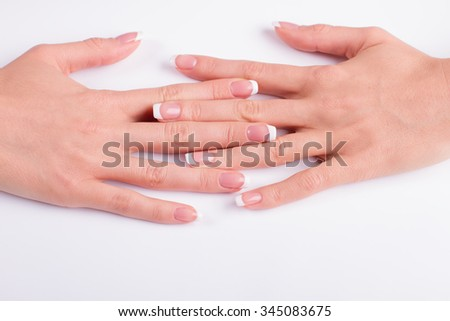 Well-groomed female hands on a white background. New manicure.