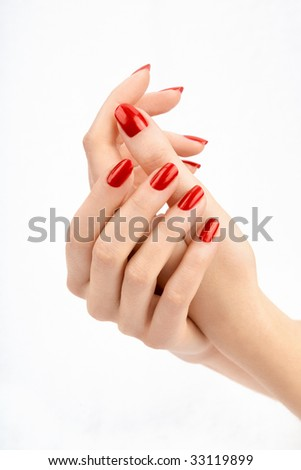 Well-groomed female hands with the beautiful manicure, isolated - stock photo