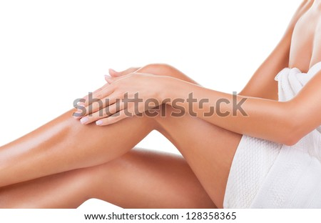 Well-groomed female legs after depilation isolated on white background - stock photo