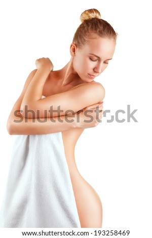 Well-groomed young woman in towel isolated on white background - stock photo