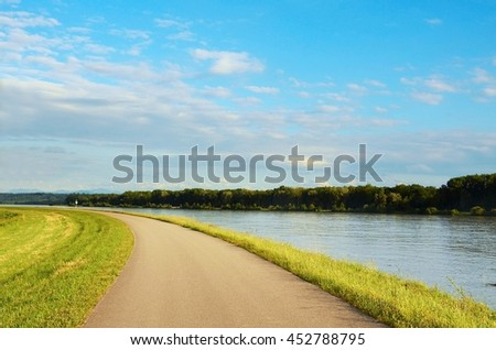 Well known Danube cycle trail running along the Danube river in Austria. Danube bicycle track is among the most beautiful, oldest and longest cycling tracks in Europe. - stock photo