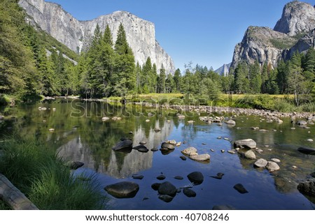 Well-known rocky monolith Al - Captain are reflected in the river Mersed in Yosemite park