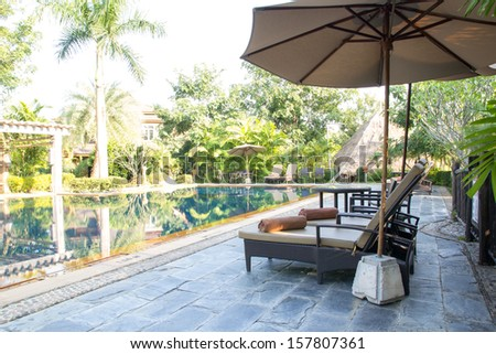 Well Landscaped Pool Area and Relaxing seats - stock photo