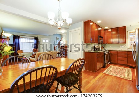 Well matched blue living room with brown tones kitchen room and dining area - stock photo