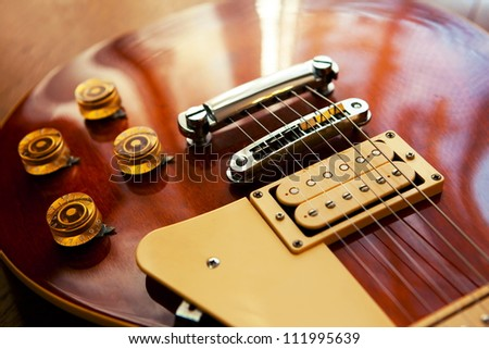 Well polished electric guitar in a jazzy pub or bar like lighting. - stock photo