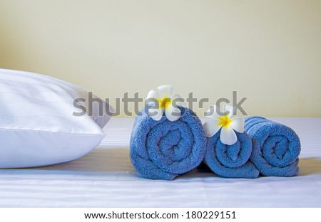 Well prepared in hotel bed with Frangipani flowers  - stock photo