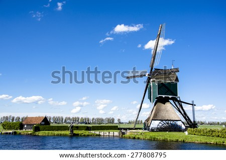 Well preserved windmill in Netherlands - stock photo