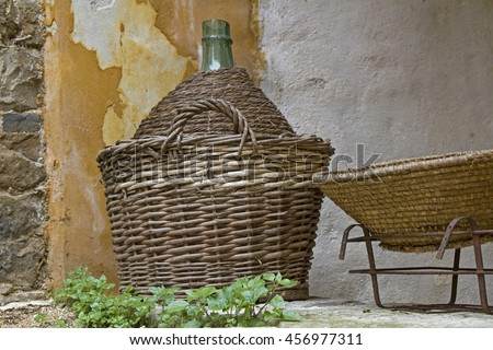 Well protected - wine bottle in basket - stock photo