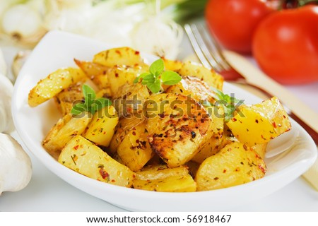 Well spiced roasted potato served as main dish - stock photo