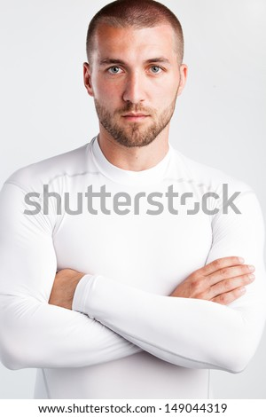 Well trained sportsman looking in to the camera - stock photo