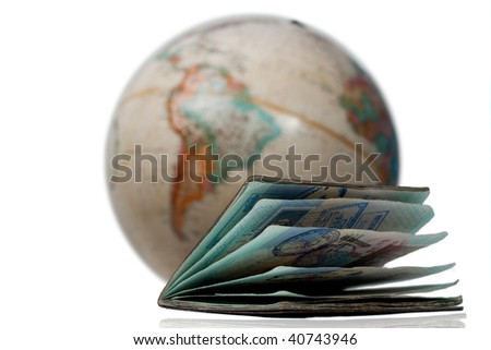 Well traveled passport with many stamps and visas in front of a map or globe of planet earth - stock photo