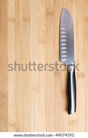 Well used chopping board and knife