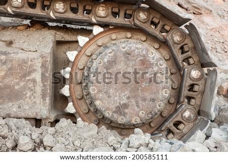 Well used excavator tracks closeup - stock photo