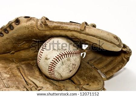 Well used glove and baseball. - stock photo