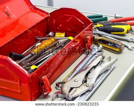 Well used old tools and red tool box - stock photo