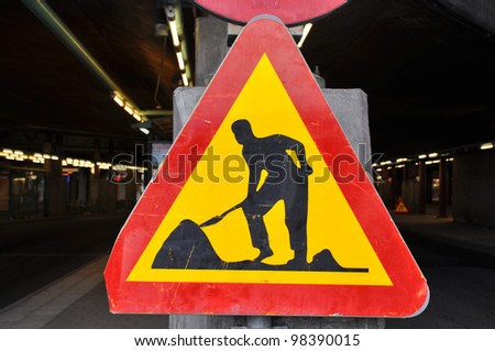 Well used roadwork traffic sign in red and yellow. - stock photo