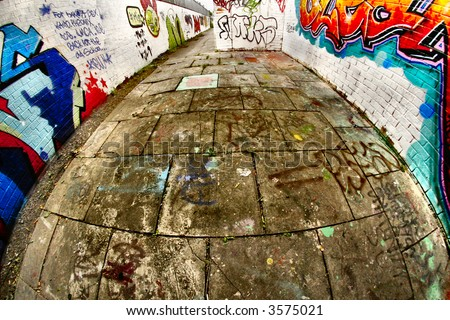 Well worked fish eye patio with graffiti - stock photo