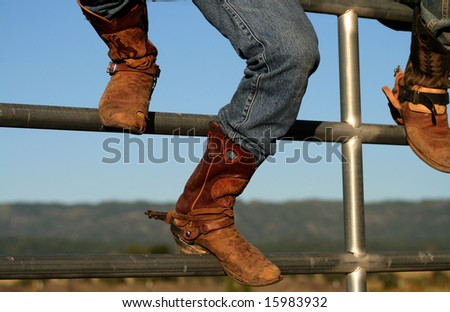Well worn boots adorn the wranglers at rodeo in small county fair, Idaho - stock photo