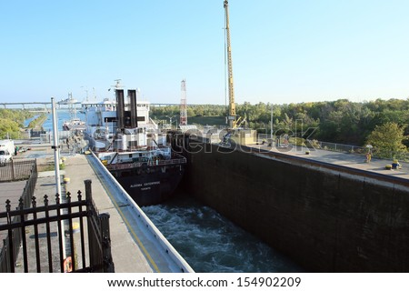 WELLAND CANAL-SEPT. 19:The Algoma Enterprise travels through Lock 3 of the Welland Canal on route from Lake Erie to Lake Ontario and the steel mills. September 19, 2013 - stock photo