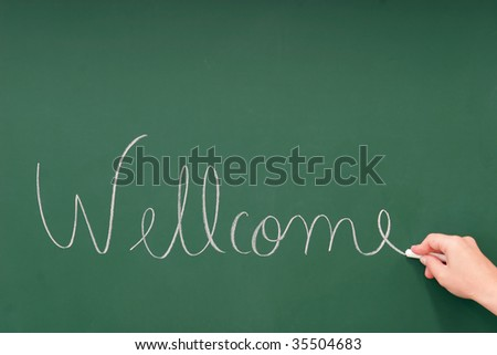 Wellcome written on a blackboard with chalk