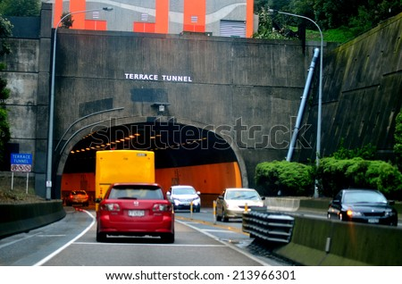 WELLINGTON - AUG 22 2014:Traffic on the Terrace Tunnel. It takes the Wellington Urban Motorway (SH1) under The Terrace in central Wellington, New Zealand. Opened in 1978, it is 460 metres in length. - stock photo