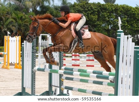 WELLINGTON, FLORIDA - AUG 21:An unidentified competitor clears a jump at the first Palm Beach County Horsemen's Association Show of the 2010-2011 season on August 21, 2010 in Wellington