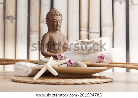 wellness and spa concept with buddha figure  - stock photo