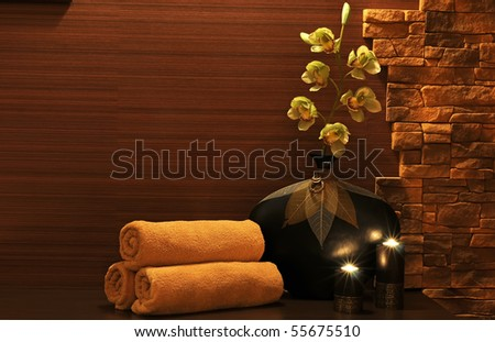 Wellness and spa concept with candles and collection of the towels. - stock photo