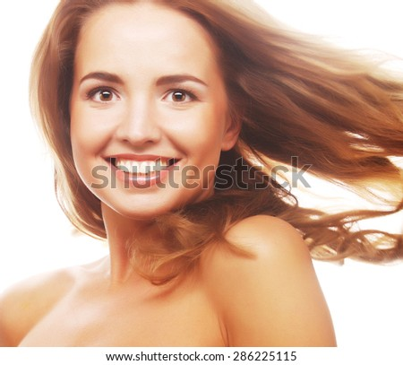 Wellness and spa. Sensual woman model with windswept flying blond hair. Shiny long health hairstyle. Beauty and haircare. - stock photo