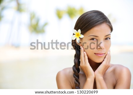 Wellness beauty portrait. Serene multicultural woman outdoors at tropical luxury spa resort. Young mixed race Asian Caucasian female model on Hawaii. - stock photo