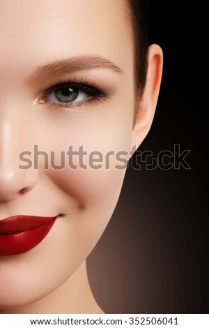 Wellness, cosmetics and chic retro style. Close-up portrait of sensuality beautiful woman model face with fashion make-up and sexy evening red lips makeup. High fashion look - stock photo