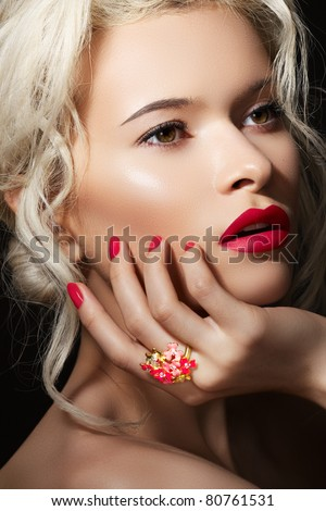 Wellness, cosmetics and romantic retro style. Close-up portrait of sensuality beautiful blond woman model face with fashion make-up, sexy evening red lips makeup and bright red manicure