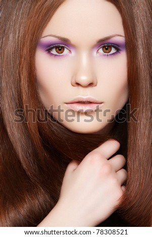 Wellness & cosmetics. Portrait of beautiful brunette woman model with healthy and shiny long straight brown hair, fashion bright neon violet make-up