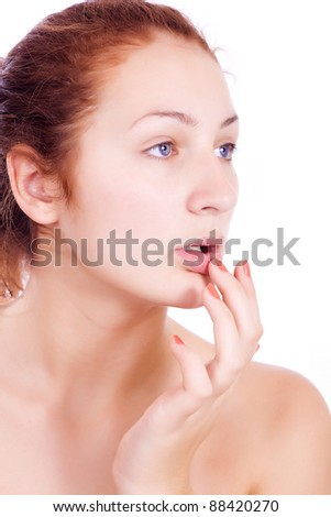 Wellness, healthcare, skin care. Lovely woman touching her lips on white backgroun. - stock photo