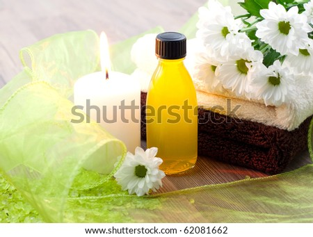 wellness picture with flower and oil - stock photo