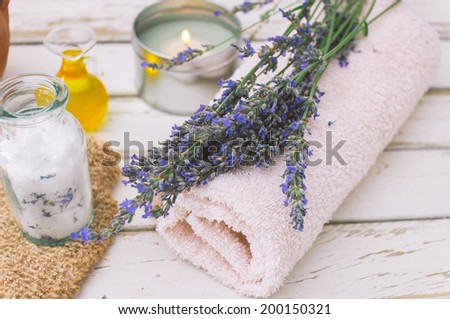 Wellness products. Candle, lavender, oil and bath-salt - stock photo