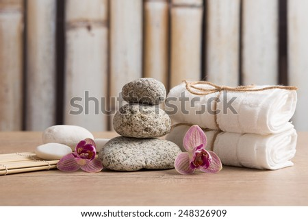 Wellness, spa composition - zen stones, towels, orchid flowers - stock photo