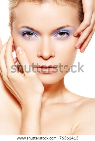 Wellness, spa portrait, healthcare and cosmetics. Sensual woman model with bright blue make-up on white background
