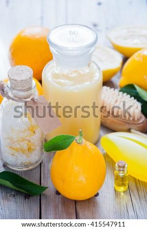 Wellness with Lemon, Lemon bath, Spa still life of organic soap, salt scrub,oil, Cosmetic cream, Shower gel and lemon - stock photo
