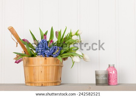 Wellness with sauna bucket and flowers