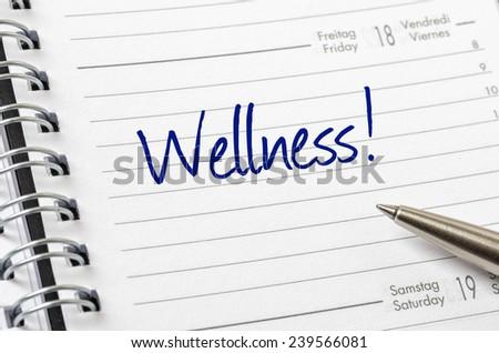 Wellness written on a calendar page - stock photo