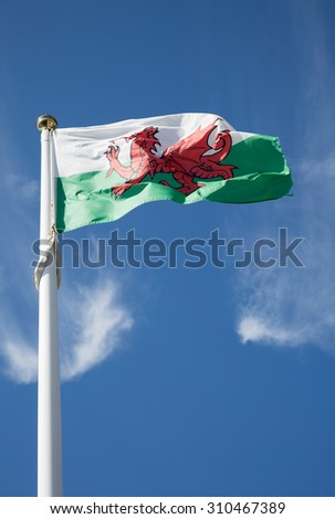 Welsh flag on a blue sky background - stock photo